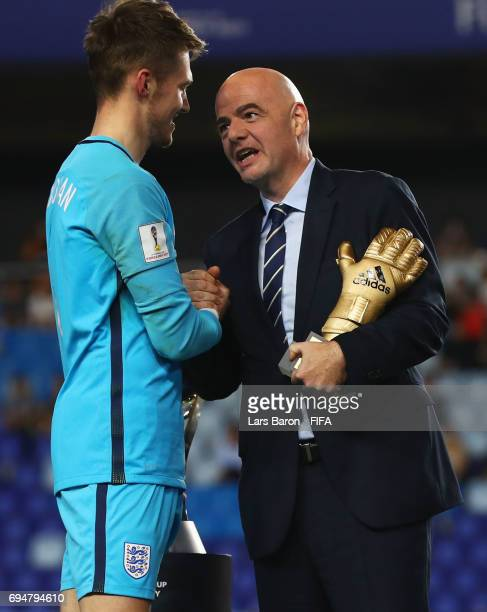 Goalkeeper Freddie Woodman of England is presented with the Golden Glove Award by FIFA President Gianni Infantino after the FIFA U20 World Cup Korea...