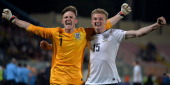 Goalkeeper Frederick Woodman of England and team mate Taylor Moore celebrate after winning the UEFA Under17 European Championship 2014 final match...