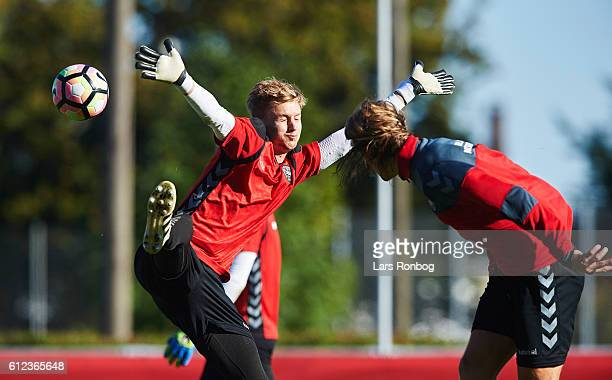 Goalkeeper Frederik Rønnow and Jannik Vestergaard in action during the Denmark training session at Helsingor Stadion on October 4 2016 in Helsingor...