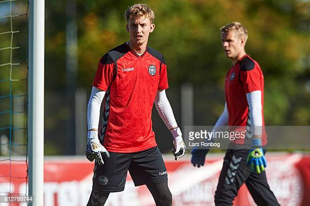 Goalkeeper Frederik Ronnow and Goalkeeper Jonas Lossl in action during the Denmark training session at Helsingor Stadion on October 4 2016 in...