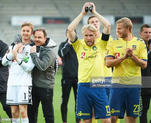 Goalkeeper Frederik Ronnow of Brondby IF Alexander Zorniger head coach of Brondby IF Johan Larsson of Brondby IF and Paulus Arajuuri of Brondby IF...