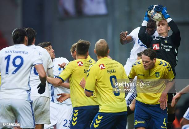 Goalkeeper Frederik Ronnow of Brondby IF and Jores Okore of FC Copenhagen compete for the ball during the Danish Alka Superliga match between FC...