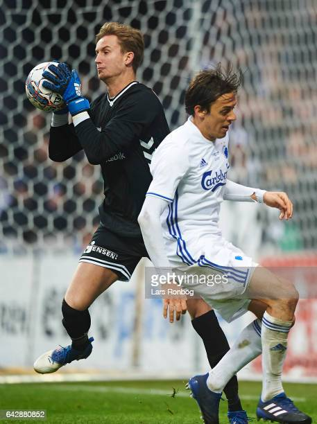 Goalkeeper Frederik Ronnow of Brondby IF and Uros Matic of FC Copenhagen compete for the ball during the Danish Alka Superliga match between FC...