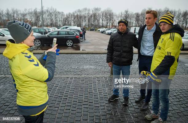 Goalkeeper Frederik Ronnow of Brondby IF arrives to the ground and haven a selfie taken with the fans prior to the Danish Alka Superliga match...