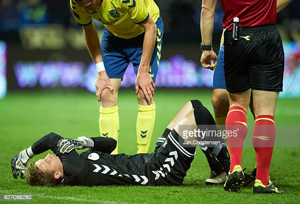 Goalkeeper Frederik Ronnow of Brondby IF get an injury during the Danish Alka Superliga match between Randers FC and Brondby IF at BioNutria Park...
