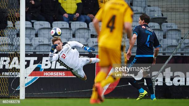 Goalkeeper Frederik Ronnow of Brondby IF saves the ball during the Danish Alka Superliga match between AC Horsens and Brondby IF at Casa Arena...