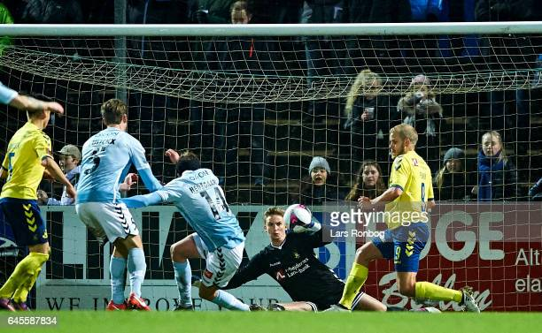 Goalkeeper Frederik Ronnow of Brondby IF saves the ball form Mikkel Hedegaard of Sonderjyske during the Danish Alka Superliga match match between...