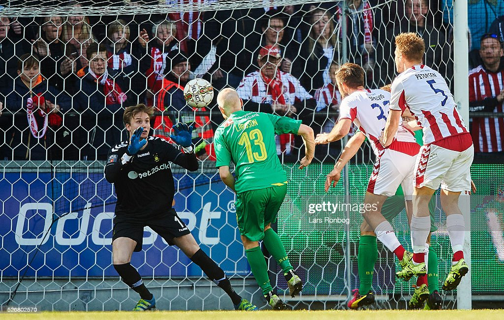 Goalkeeper Frederik Ronnow of Brondby IF saves the ball from Lukas Spalvis of AaB Aalborg during the Danish Alka Superliga match between AaB Aalborg and Brondby IF at Nordjyske Arena on May 1, 2016 in Aalborg, Denmark.