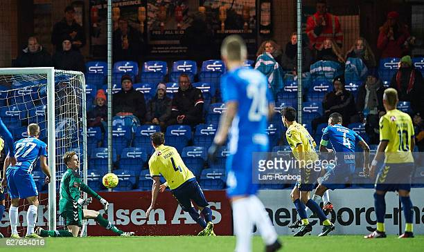 Goalkeeper Frederik Ronnow of Brondby IF saves the ball from Victor Palsson of Esbjerg fB during the Danish Alka Superliga match between Esbjerg fB...