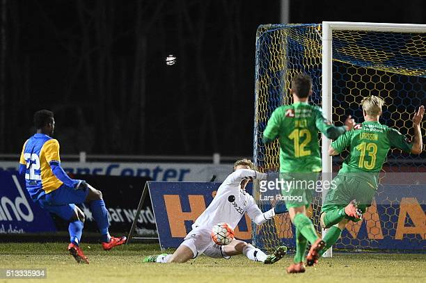 Goalkeeper Frederik Ronnow of Brondby IF saves the shot from Musefiu Ashiru of Skive IK during the Danish Cup DBU Pokalen quarterfinal match between...
