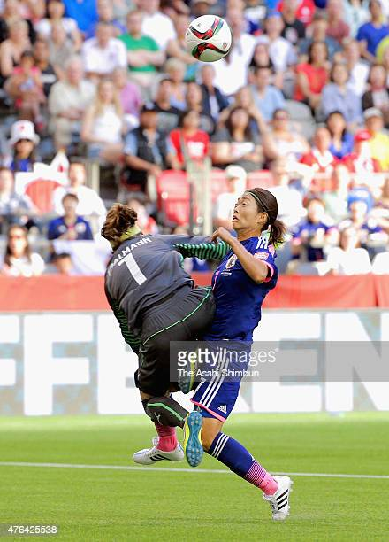 Goalkeeper Gaelle Thalmann of Switzerland fouls Kozue Ando of Japan and gives away a penalty during the FIFA Women's World Cup 2015 Group C match...