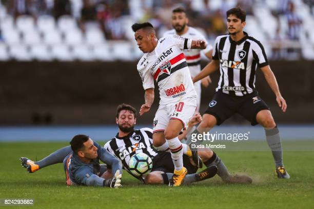 Goalkeeper Gatito Fernandez and Joao Paulo of Botafogo struggle for the ball with Cueva of Sao Paulo during a match between Botafogo and Sao Paulo as...