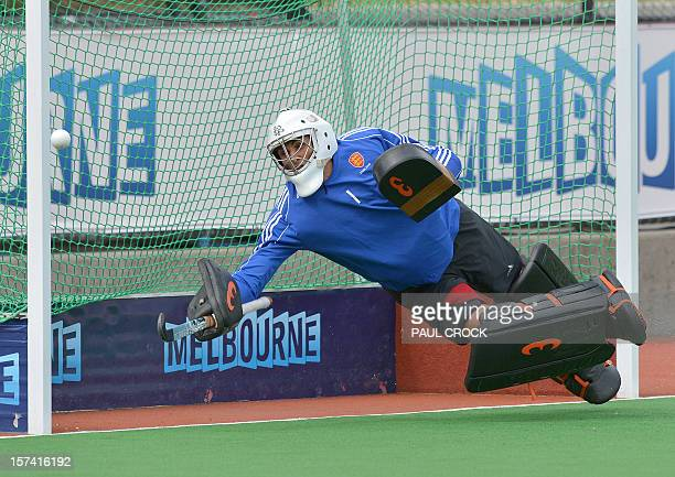 Goalkeeper George Pinner of England dives for a ball during a practice session for the Men's Hockey Champions Trophy tournament in Melbourne on...