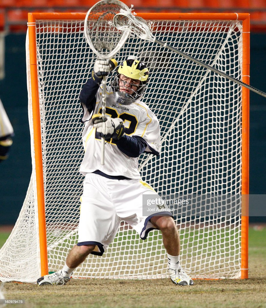Goalkeeper Gerald Logan #22 of the Michigan Wolverines defends the goal against the Army Black Knights during the 2013 Orange Bowl Lacrosse Classic on March 2, 2013 at SunLife Stadium in Miami Gardens, Florida.