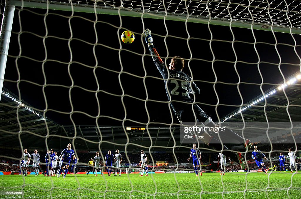 Goalkeeper <a gi-track='captionPersonalityLinkClicked' href=/galleries/search?phrase=Gerhard+Tremmel&family=editorial&specificpeople=751125 ng-click='$event.stopPropagation()'>Gerhard Tremmel</a> of Swansea dives in vain as the freekick from <a gi-track='captionPersonalityLinkClicked' href=/galleries/search?phrase=Ross+Barkley&family=editorial&specificpeople=5806369 ng-click='$event.stopPropagation()'>Ross Barkley</a> of Everton flies into the net for the matchwinning goal during the Barclays Premier League match between Swansea City and Everton at the Liberty Stadium on December 22, 2013 in Swansea, Wales.