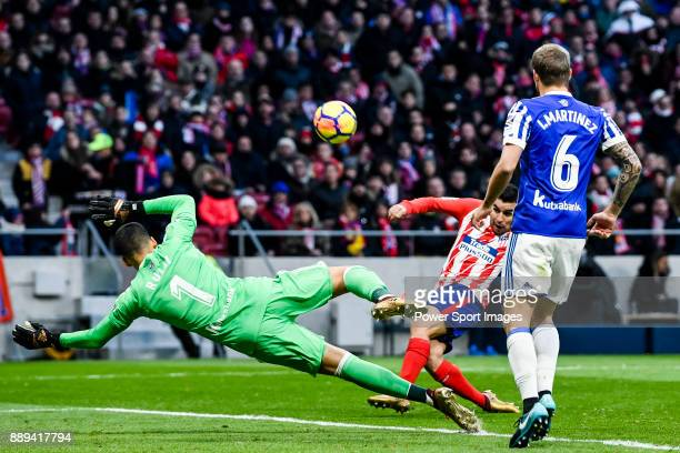 Goalkeeper Geronimo Rulli of Real Sociedad reaches for the ball after an attempt at goal by Angel Correa of Atletico de Madrid during the La Liga...