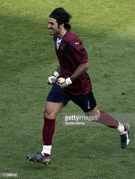 Goalkeeper Gianluigi Buffon of Italy celebrates after teammate Francesco Totti scores the match winning penalty during the FIFA World Cup Germany...