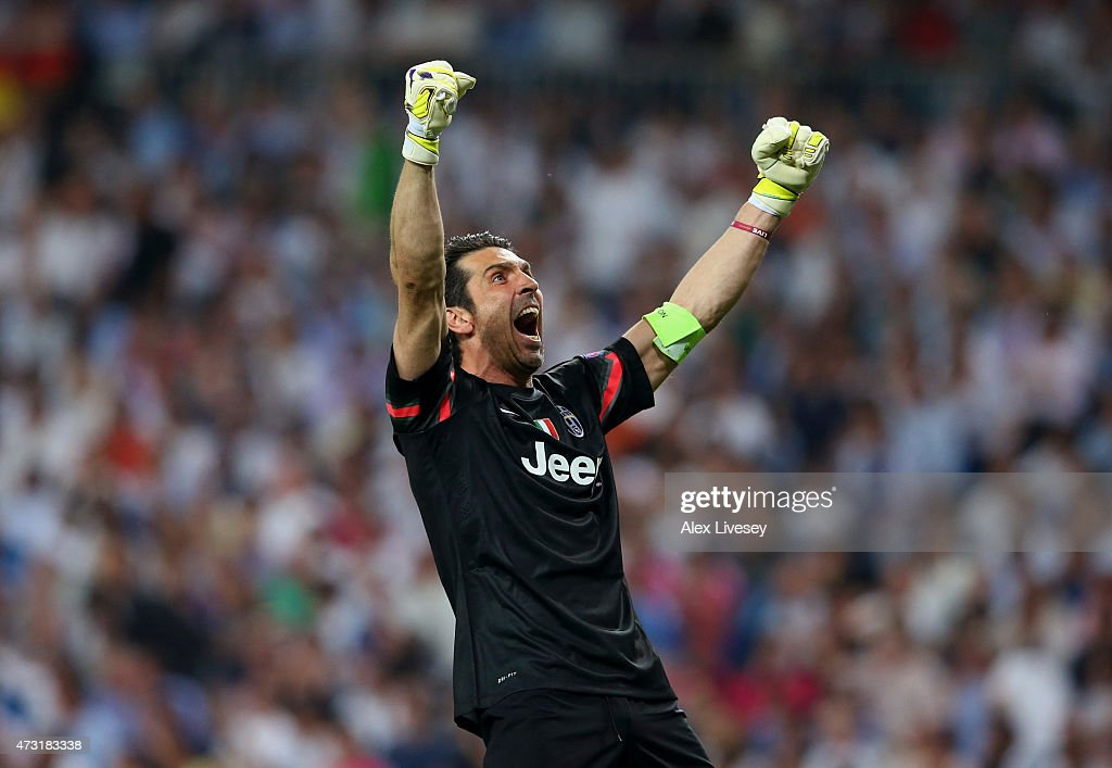 Goalkeeper <a gi-track='captionPersonalityLinkClicked' href=/galleries/search?phrase=Gianluigi+Buffon&family=editorial&specificpeople=208860 ng-click='$event.stopPropagation()'>Gianluigi Buffon</a> of Juventus celebrates after teammate Alvaro Morata of Juventus scores a goal to level the scores at 1-1 during the UEFA Champions League Semi Final, second leg match between Real Madrid and Juventus at Estadio Santiago Bernabeu on May 13, 2015 in Madrid, Spain.