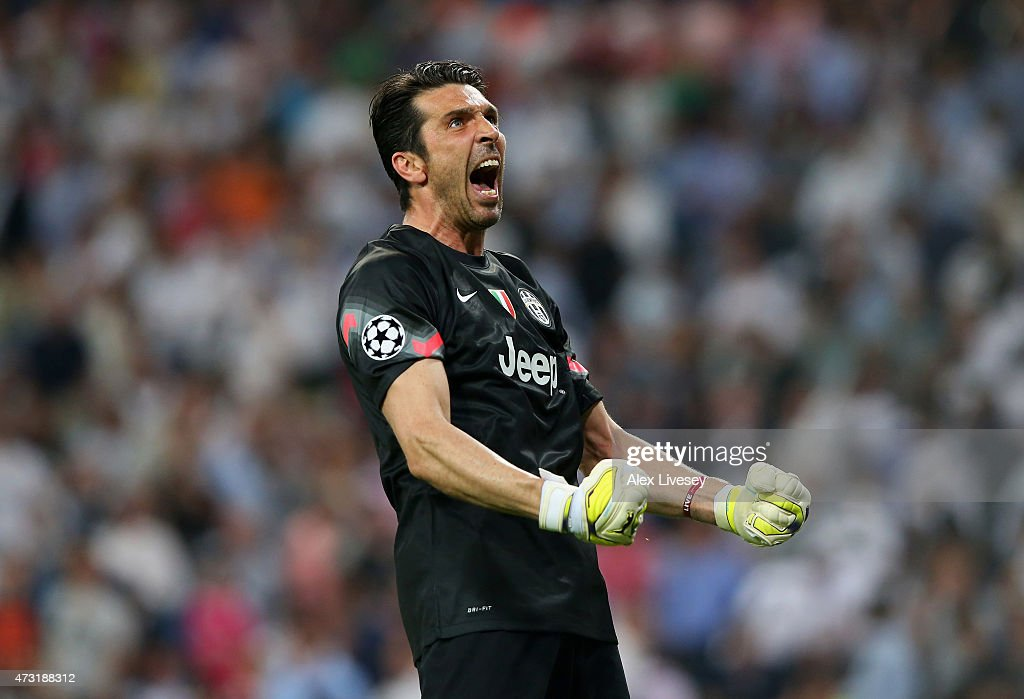 Goalkeeper <a gi-track='captionPersonalityLinkClicked' href=/galleries/search?phrase=Gianluigi+Buffon&family=editorial&specificpeople=208860 ng-click='$event.stopPropagation()'>Gianluigi Buffon</a> of Juventus celebrates following his team's progression to the final during the UEFA Champions League Semi Final, second leg match between Real Madrid and Juventus at Estadio Santiago Bernabeu on May 13, 2015 in Madrid, Spain.