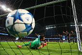 Goalkeeper Gianluigi Buffon of Juventus dives in vain as Vincent Kompany of Manchester City pressures Giorgio Chiellini of Juventus into scoring an...