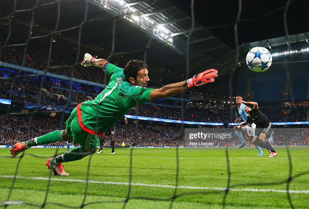 Goalkeeper <a gi-track='captionPersonalityLinkClicked' href=/galleries/search?phrase=Gianluigi+Buffon&family=editorial&specificpeople=208860 ng-click='$event.stopPropagation()'>Gianluigi Buffon</a> of Juventus dives in vain as <a gi-track='captionPersonalityLinkClicked' href=/galleries/search?phrase=Vincent+Kompany&family=editorial&specificpeople=504694 ng-click='$event.stopPropagation()'>Vincent Kompany</a> of Manchester City pressures <a gi-track='captionPersonalityLinkClicked' href=/galleries/search?phrase=Giorgio+Chiellini&family=editorial&specificpeople=605793 ng-click='$event.stopPropagation()'>Giorgio Chiellini</a> of Juventus into scoring an own goal for their first during the UEFA Champions League Group D match between Manchester City FC and Juventus at the Etihad Stadium on September 15, 2015 in Manchester, United Kingdom.