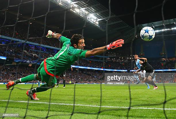 Goalkeeper Gianluigi Buffon of Juventus dives in vain as Vincent Kompany of Manchester City pressures Giorgio Chiellini of Juventus into scoring an...