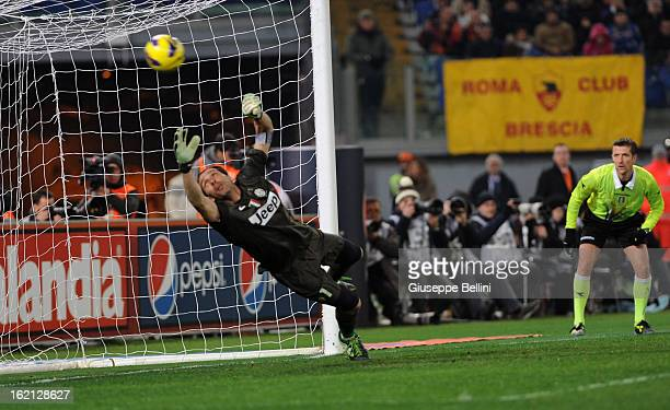 Goalkeeper Gianluigi Buffon of Juventus fails to stop the opening goal being scored by Francesco Totti of Roma during the Serie A match between AS...