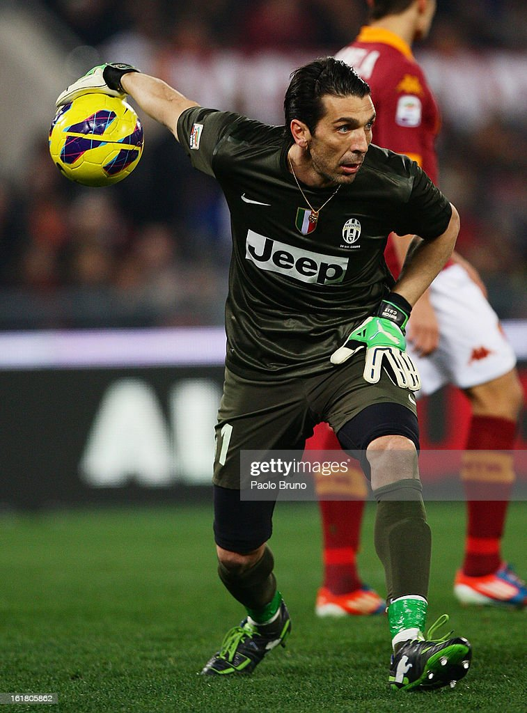 Goalkeeper Gianluigi Buffon of Juventus FC throws the ball during the Serie A match between AS Roma and Juventus FC at Stadio Olimpico on February 16, 2013 in Rome, Italy.