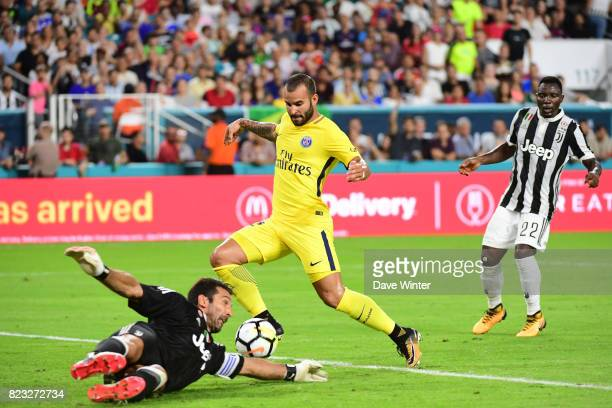 Goalkeeper Gianluigi Buffon of Juventus gets a vital touch to divert the bazll away from Jese Rodriguez Ruiz of PSG during the International...
