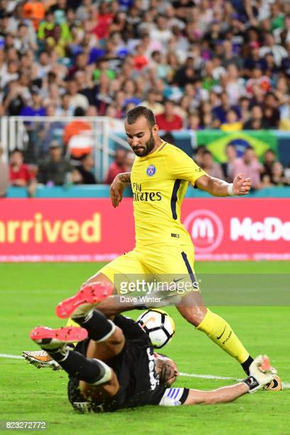 Goalkeeper Gianluigi Buffon of Juventus gets a vital touch to divert the ball away from Jese Rodriguez Ruiz of PSG during the International Champions...