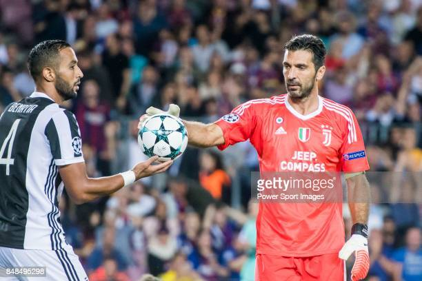 Goalkeeper Gianluigi Buffon of Juventus gets the ball from Medhi Benatia of Juventus during the UEFA Champions League 201718 match between FC...