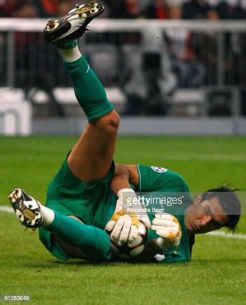 Goalkeeper Gianluigi Buffon of Juventus saves a shot during the UEFA Champions League Group A match between FC Bayern Muenchen and Juventus Turin at...