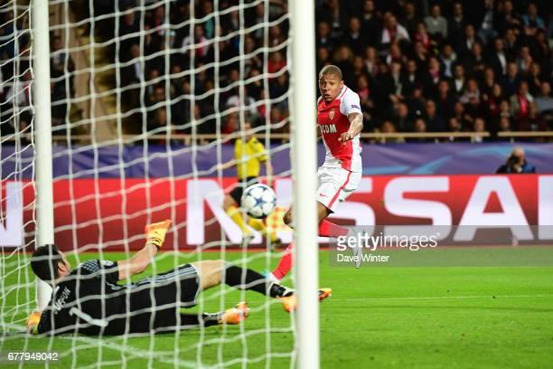 Goalkeeper Gianluigi Buffon of Juventus saves from Kylian Mbappe of Monaco during the Uefa Champions League match semi final first leg between As...