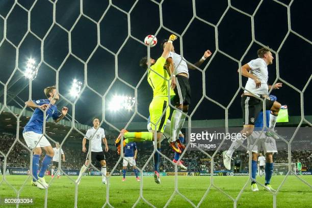 Goalkeeper Gianluigi Donnarumma of Italy and Davie Selke of Germany battle for the ball during the UEFA U21 championship match between Italy and...