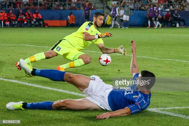 Goalkeeper Gianluigi Donnarumma of Italy and Mattia Caldara of Italy in action during the UEFA U21 championship match between Italy and Germany at...