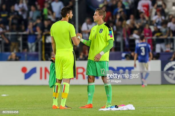 Goalkeeper Gianluigi Donnarumma of Italy Goalkeeper Julian Pollersbeck of Germany during the UEFA U21 championship match between Italy and Germany at...
