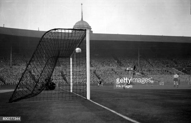 Goalkeeper Gil Merrick of Birmingham City makes a flying effort but fails to stop Nandor Hidekguti from scoring the first goal for Hungary in the...