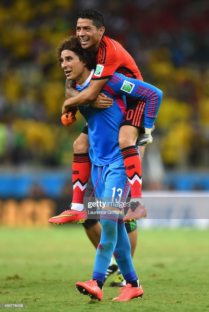 Goalkeeper <a gi-track='captionPersonalityLinkClicked' href=/galleries/search?phrase=Guillermo+Ochoa&family=editorial&specificpeople=490875 ng-click='$event.stopPropagation()'>Guillermo Ochoa</a> of Mexico celebrates with <a gi-track='captionPersonalityLinkClicked' href=/galleries/search?phrase=Javier+Aquino&family=editorial&specificpeople=7218711 ng-click='$event.stopPropagation()'>Javier Aquino</a> after their 0-0 draw with Brazil during the 2014 FIFA World Cup Brazil Group A match between Brazil and Mexico at Castelao on June 17, 2014 in Fortaleza, Brazil.