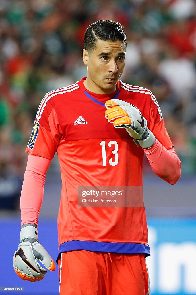 Goalkeeper <a gi-track='captionPersonalityLinkClicked' href=/galleries/search?phrase=Guillermo+Ochoa&family=editorial&specificpeople=490875 ng-click='$event.stopPropagation()'>Guillermo Ochoa</a> #13 of Mexico during the 2015 CONCACAF Gold Cup group C match against Guatemala at University of Phoenix Stadium on July 12, 2015 in Glendale, Arizona. Guatemala and Mexico finished in a 0-0 tie.
