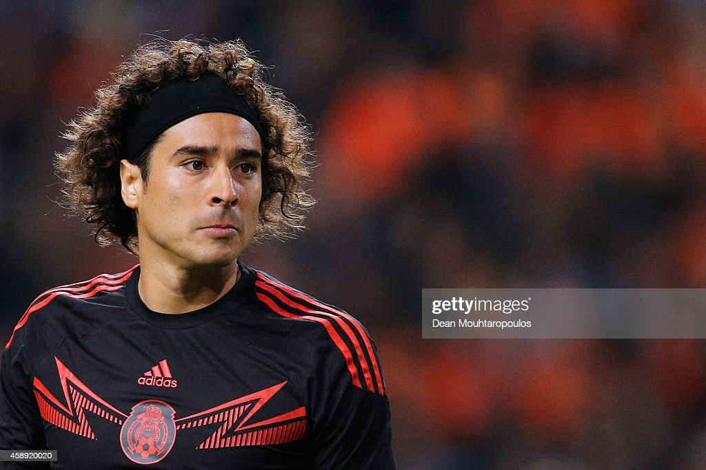 Goalkeeper, <a gi-track='captionPersonalityLinkClicked' href=/galleries/search?phrase=Guillermo+Ochoa&family=editorial&specificpeople=490875 ng-click='$event.stopPropagation()'>Guillermo Ochoa</a> of Mexico looks ot the ball during the international friendly match between Netherlands and Mexico held at the Amsterdam ArenA on November 12, 2014 in Amsterdam, Netherlands.