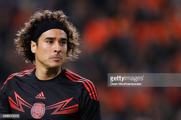 Goalkeeper Guillermo Ochoa of Mexico looks ot the ball during the international friendly match between Netherlands and Mexico held at the Amsterdam...