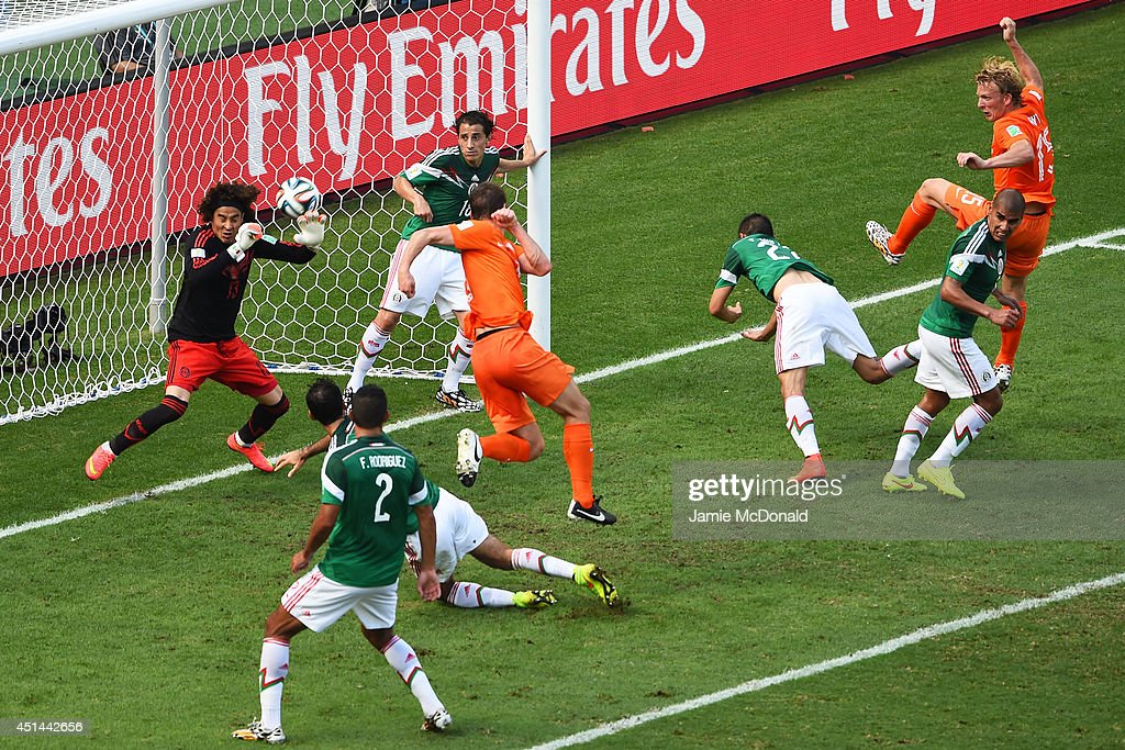 Goalkeeper <a gi-track='captionPersonalityLinkClicked' href=/galleries/search?phrase=Guillermo+Ochoa&family=editorial&specificpeople=490875 ng-click='$event.stopPropagation()'>Guillermo Ochoa</a> of Mexico makes a save after a shot at goal by Stefan de Vrij of the Netherlands during the 2014 FIFA World Cup Brazil Round of 16 match between Netherlands and Mexico at Castelao on June 29, 2014 in Fortaleza, Brazil.
