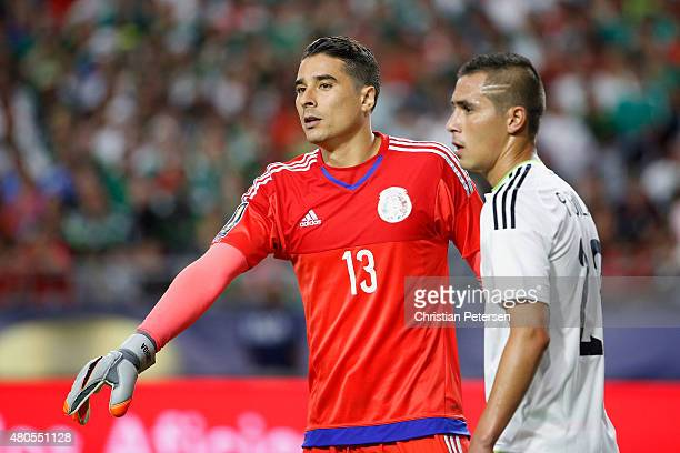 Goalkeeper Guillermo Ochoa of Mexico prepares to defend a corner kick with Paul Aguilar during the 2015 CONCACAF Gold Cup group C match against...
