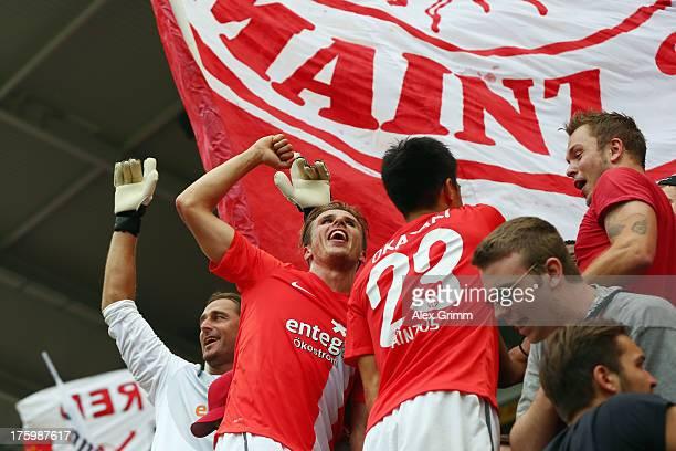 Goalkeeper Heinz Mueller Nicolai Mueller and Shinji Okazaki celebrate with the fans after the Bundesliga match between 1 FSV Mainz 05 and VfB...