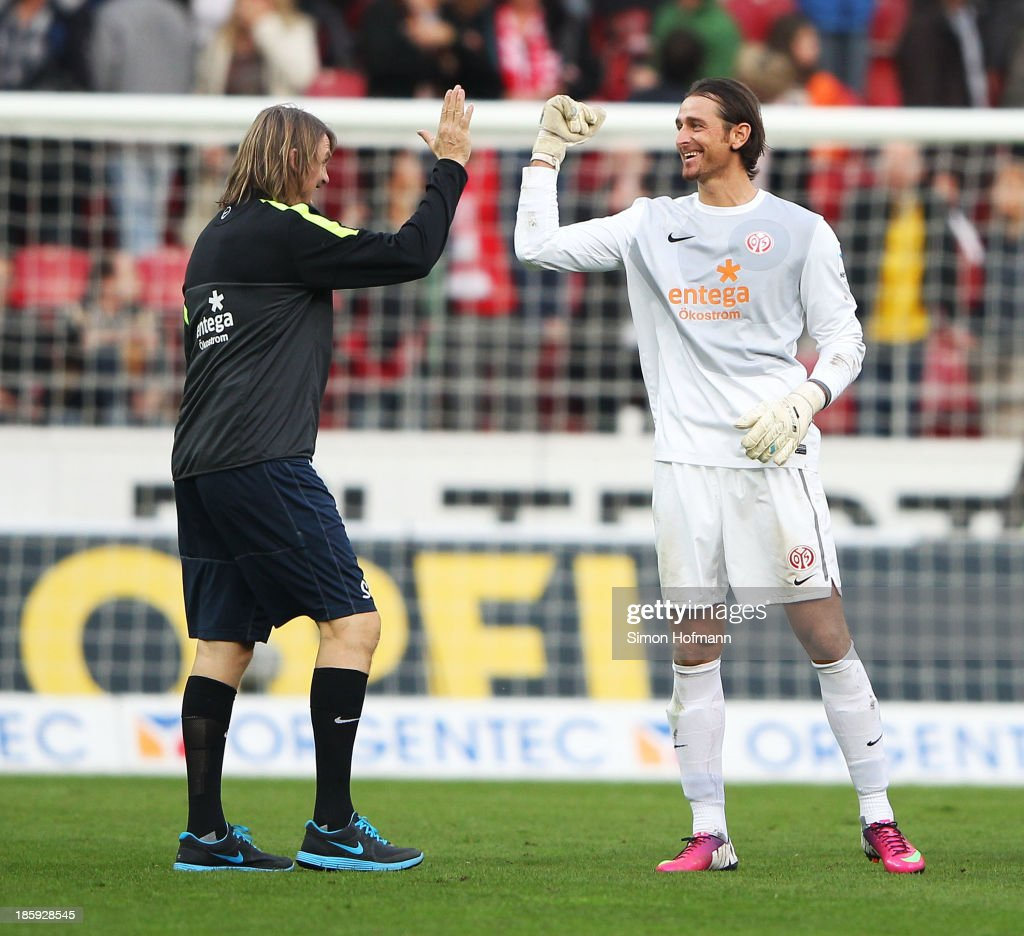 Goalkeeper <a gi-track='captionPersonalityLinkClicked' href=/galleries/search?phrase=Heinz+Mueller&family=editorial&specificpeople=5967792 ng-click='$event.stopPropagation()'>Heinz Mueller</a> of Mainz (R) celebrates winning after the Bundesliga match between 1. FSV Mainz and Eintracht Braunschweig at Coface Arena on October 26, 2013 in Mainz, Germany.