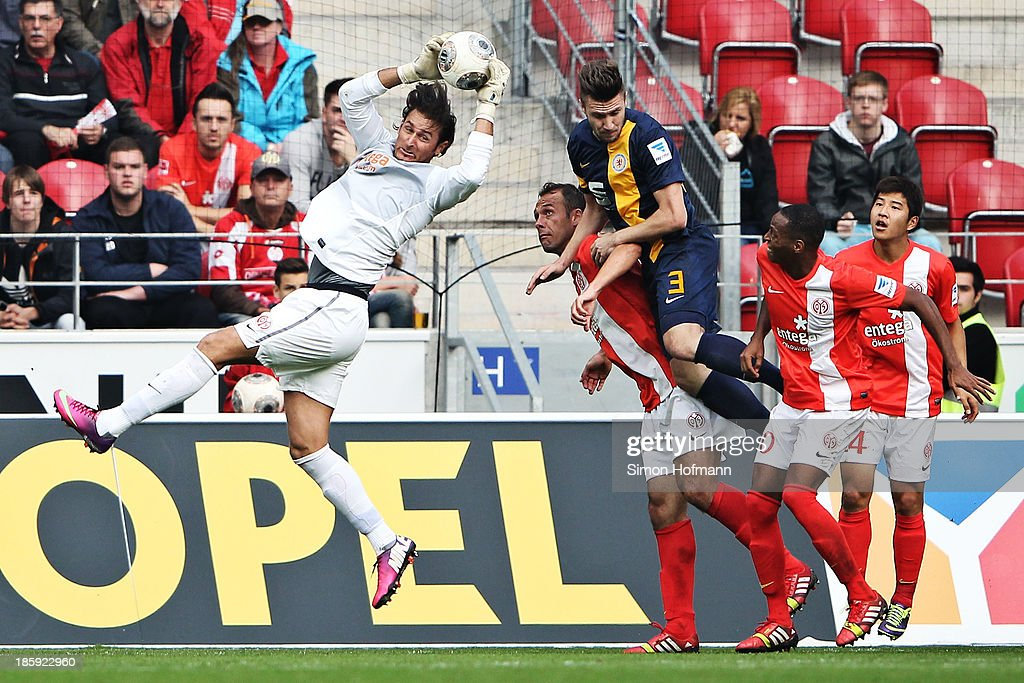 Goalkeeper <a gi-track='captionPersonalityLinkClicked' href=/galleries/search?phrase=Heinz+Mueller&family=editorial&specificpeople=5967792 ng-click='$event.stopPropagation()'>Heinz Mueller</a> of Mainz makes a save against Ermin Bicakcic of Braunschweig during the Bundesliga match between 1. FSV Mainz and Eintracht Braunschweig at Coface Arena on October 26, 2013 in Mainz, Germany.