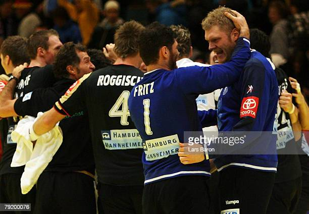 Goalkeeper Henning Fritz and Johannes Bitter of Germany celebrate after winning the Men's Handball European Championship main round Group II match...