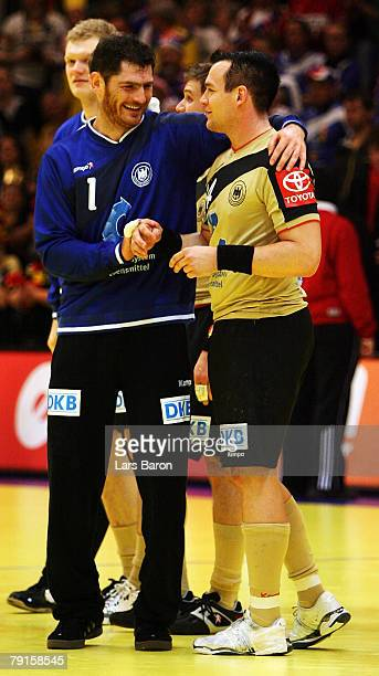 Goalkeeper Henning Fritz celebrates with team mate Christian Zeitz after winning the Men's Handball European Championship main round Group II match...