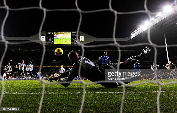 Goalkeeper Heurelho Gomes of Spurs saves the penalty from Didier Drogba of Chelsea to keep the score at 11 during the Barclays Premier League match...