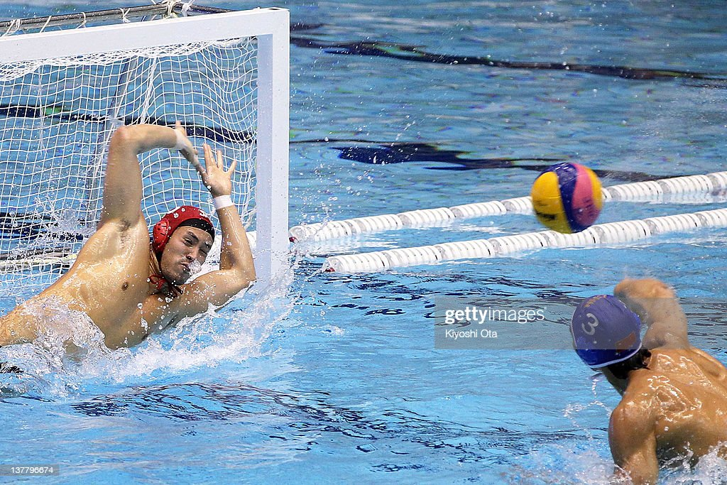 Goalkeeper Hideyuki Tanamura of Japan makes a save from a penalty by <a gi-track='captionPersonalityLinkClicked' href=/galleries/search?phrase=Liang+Zhongxing&family=editorial&specificpeople=4063035 ng-click='$event.stopPropagation()'>Liang Zhongxing</a> of China during the Asian Water Polo Championships 2012 match between Japan and China at Chiba International General Swimming Center on January 27, 2012 in Narashino, Japan.